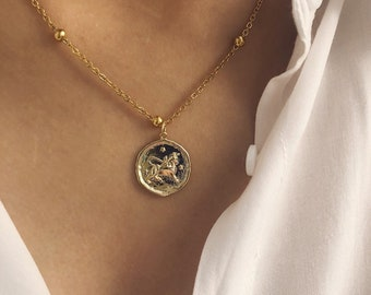 Necklaces with golden steel chain and zodiac sign pendant