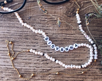Chain of glasses with river pearls, golden steel chain and name