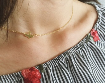 Necklace with brass chain and swallow pendant in silver 925 gold-plated
