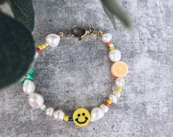Bracelet with natural pearls in various shapes, multicolor beads, smiley faces and fruit in polymer clay
