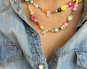 Necklace with colored resin beads and mother of pearl initial