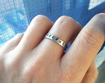 Thin ring in aluminum engraved by hand