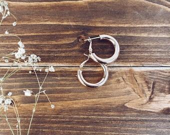 Hoop earrings in golden steel