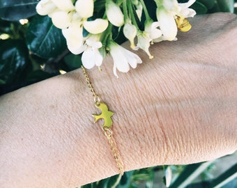 Bracelet with brass chain and swallow pendant in sterling silver 925 gold