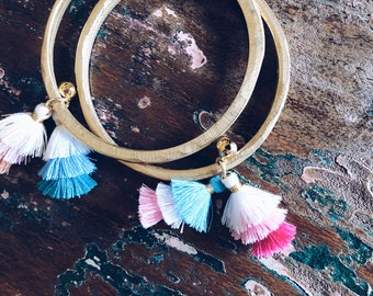 Brass bracelets with tassels and bell