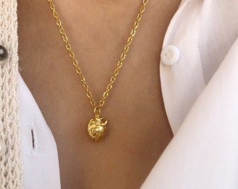 Necklace with golden steel chain and human heart in gold plated brass
