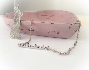 Brass necklace with New York skyline