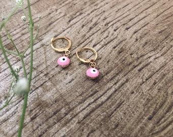 Brass hoop earrings with blue Greek eye pendant