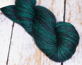 Hand Dyed Yarn DK Superwash Merino Wool  in Green and Navy variegated