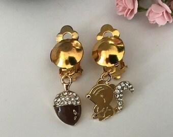 Asymmetrical clip earrings, tassel and squirrel gold metal and enamel