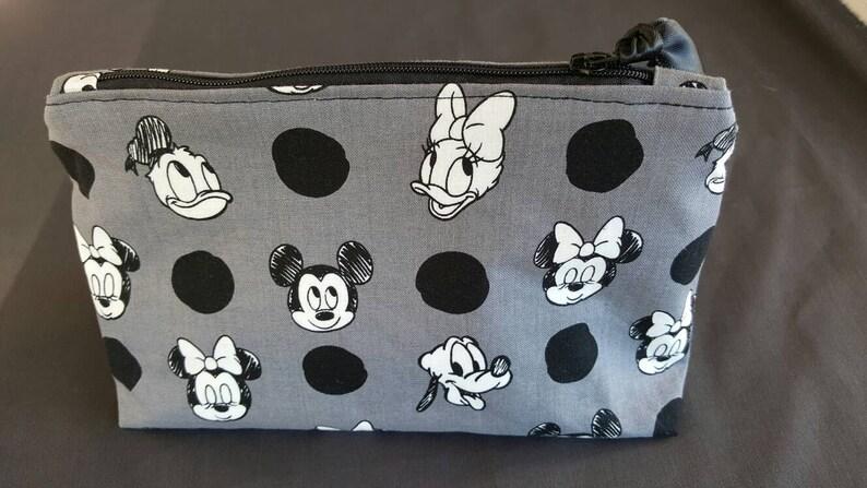 3a955b1e4b Mickey Minnie Donald Daisy Pluto and polka dots cosmetic