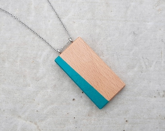 Rectangle pendant wood hand painted, made of beech of Canada. Black geometric pattern on stainless steel chain.