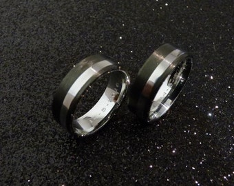 Stainless steel & carbon fiber wedding rings.