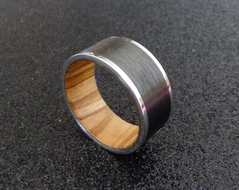 Stainless steel and carbon fiber with olive wood inner ring