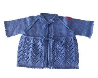 Ultra feminine baby sweater, medium blue,, size 24 months, hand knit. The perfect baby gift.