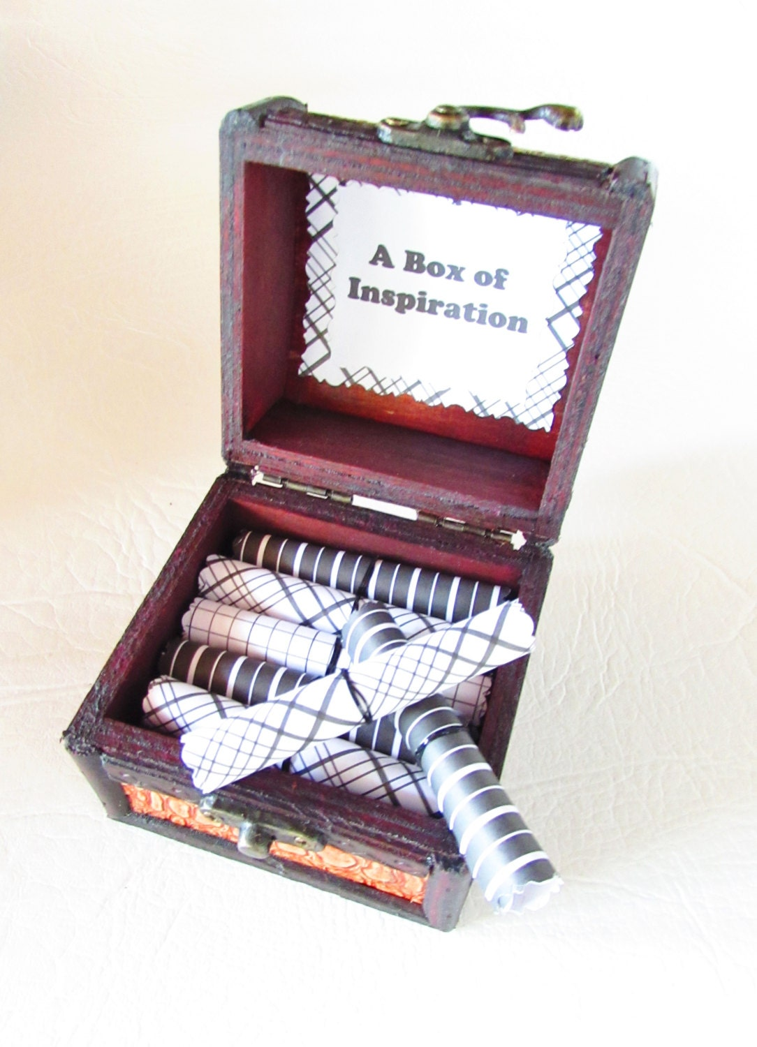 a box of inspiration graduation quotes in a wood box motivational