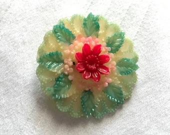 Gorgeous celluloid flower burst pin brooch