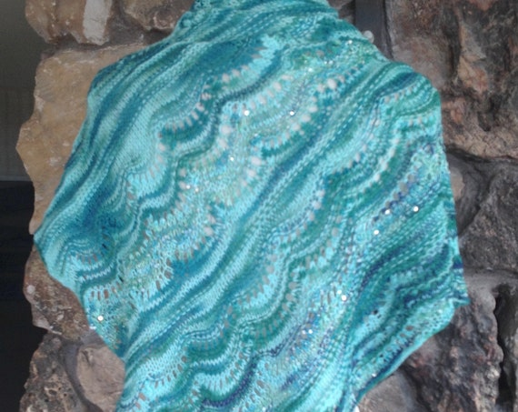 COLORS OF ICEBERGS collected in triangle Wrap of soft Merino/Cashmere with silken yarns full of beads and sequins.