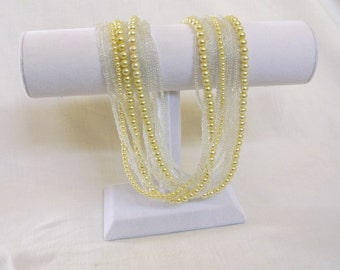 Handbeaded multi-strand, pearl and glass bead necklace