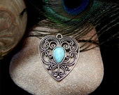 Antique Burnished Silver Open Filigree Designed Heart With Inlaid Turquoise Howlite Teardrop Stone