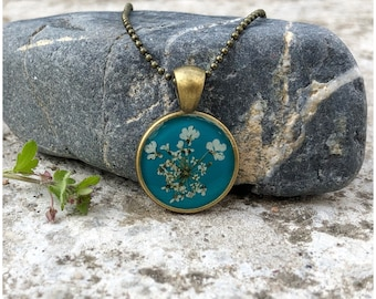 turquoise jewellery   real wild carrot flowers   around   bronze gift idea from the heart