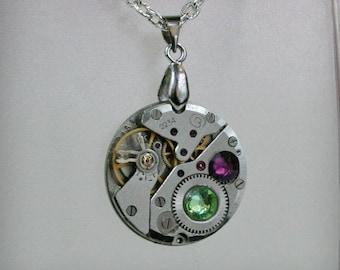 Watch movement  Steampunk   Pendant with Peridot , Amethyst  Swarovski crystal ,  Steampunk Jewelry , Steampunk Jewelry , Clockwork Pendant
