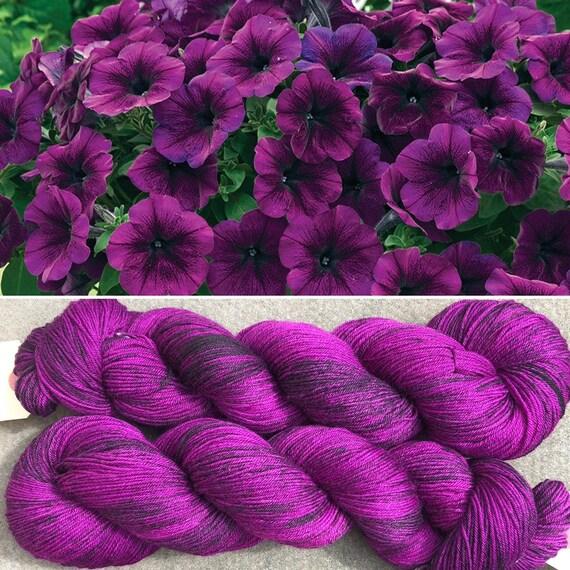 Purple Petunia, black speckled merino nylon sock yarn
