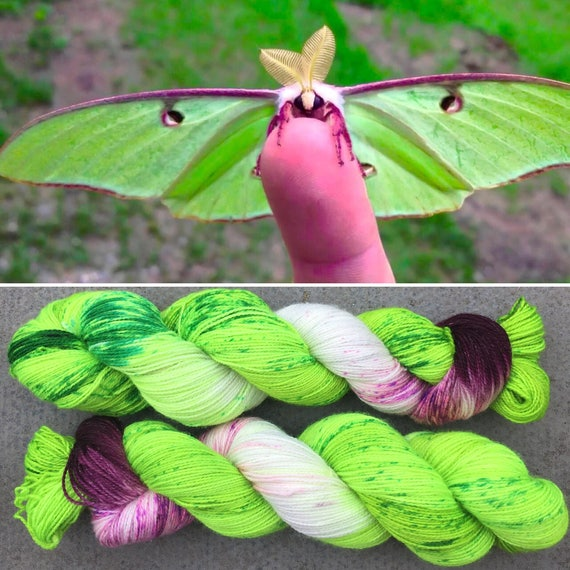 Sparkly Luna Moth, green purple merino nylon UV reactive speckled sparkle sock yarn