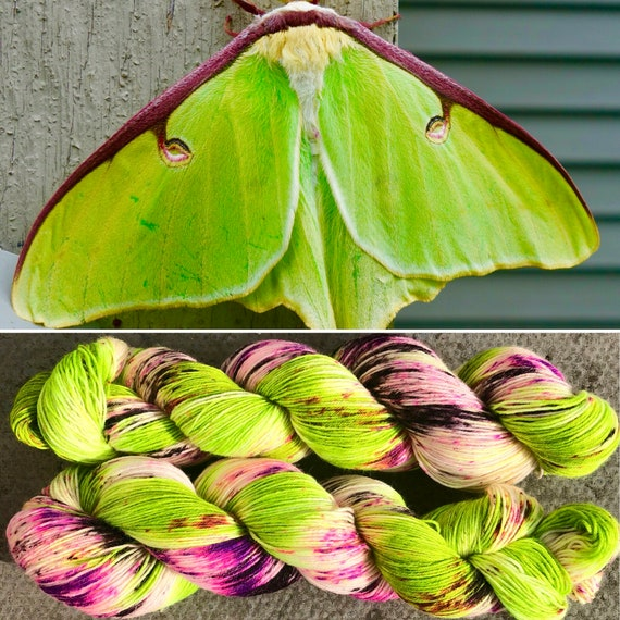 Luna Moth II, green purple 75/25 merino nylon UV reactive speckled sock yarn