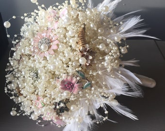 Dusky pink and ivory wedding bouquet with vintage brooches and pearls with feather collar. Bridal bouquet. Vintage bouquet.