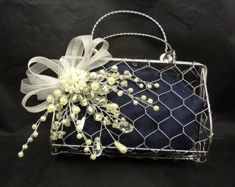 Flower girl metal handbag with a pearl and silver corsage and navy organza background. Pearl brooch bridesmaids handbag, Flowergirl bag