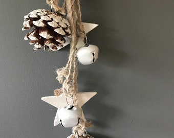 Christmas door hanger with stars wnd cones and bells. Christmas decoration, wsll decoration, door decoration.