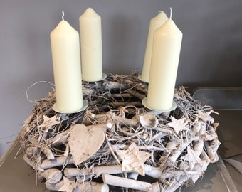 Large advent wreath with hearts and stars in white. Table decoration. Christmas centrepiece.