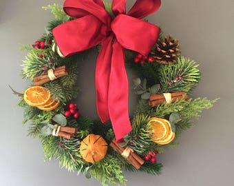 Artificial Christmas door wreath, xmas wreath with cones, oranges, limes, cinnamon sticks, berties and orange slices