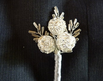 Modern silver wire bauble buttonhole, boutonniere for groom, best man, ushers, father of the bride with silverribbon and seed bead leaves.