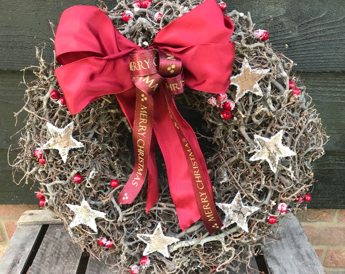 Featured listing image: 18 inch Christnas wreath in bonsai wood with birch stars and berries and finished with luxury ribbon bow. Door wreath, christmas decoration.