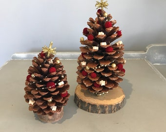 Pine Cone Christmas tree on a Wooden Base, Decorated Pine Cone Tree, Table Decoration. Christmas Decoration