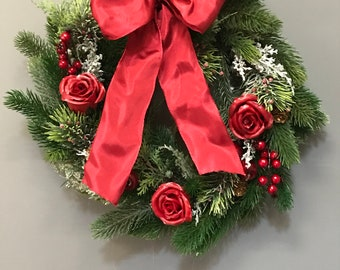 Christmas Red Winter Wreath With waxed Red Roses Apples, Berries and Cones. Xmas door Wreath. Christmas Decoration