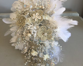 Cascade bouquet in white ivory and silver with beads, lace, feather and brooches. Brooch bouquet, french beaded bouquet.