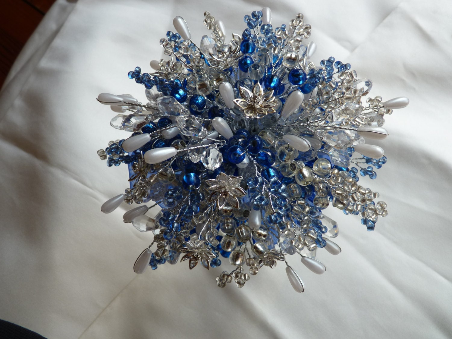 53a5bedf9bd Wedding bouquet in royal blue and silver with crystal flowers, pearls ...