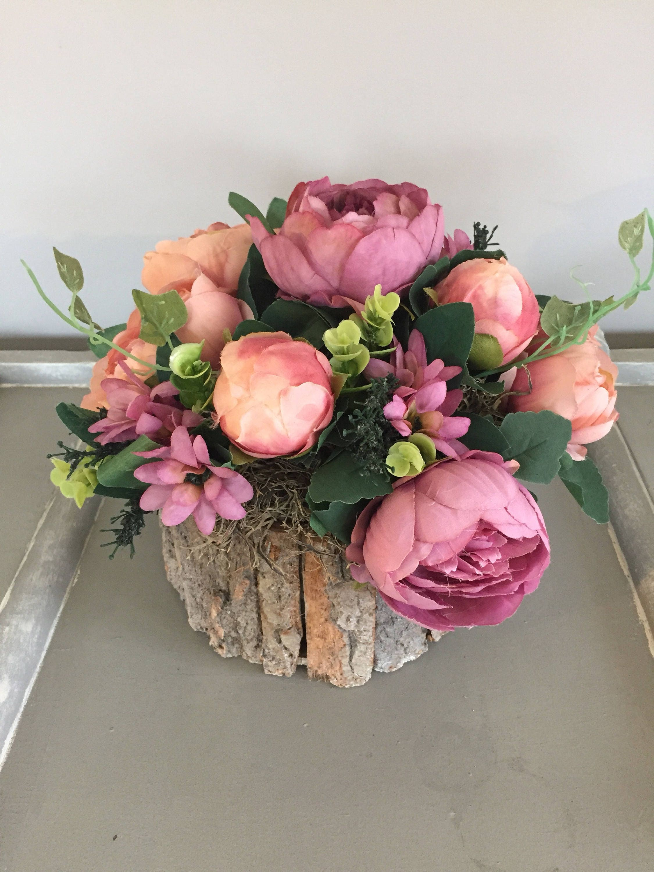 Summer Flower Arrangement With Dusky Pink Peonys Greenery And Moss