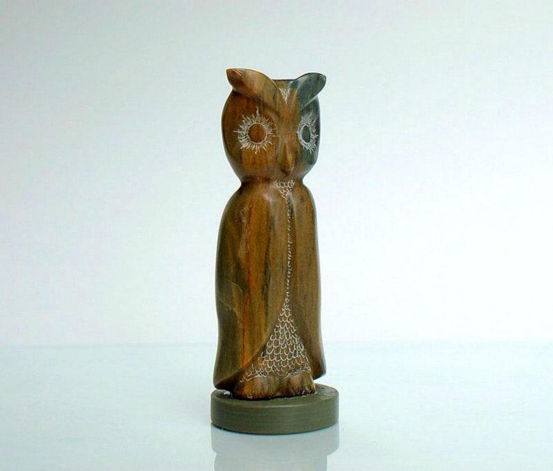 Brown soapstone owl figurine on green base