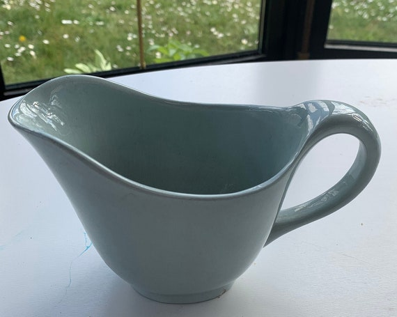 Bluish gray earthenware saucer, stamped longwy france art deco