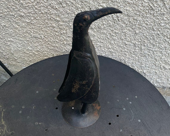 Penguin in metal, vintage plant and garden decoration