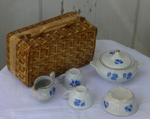 Charming old dinette for porcelain dolls, blue flowers patterns, art deco with a vintage bamboo and wicker basket