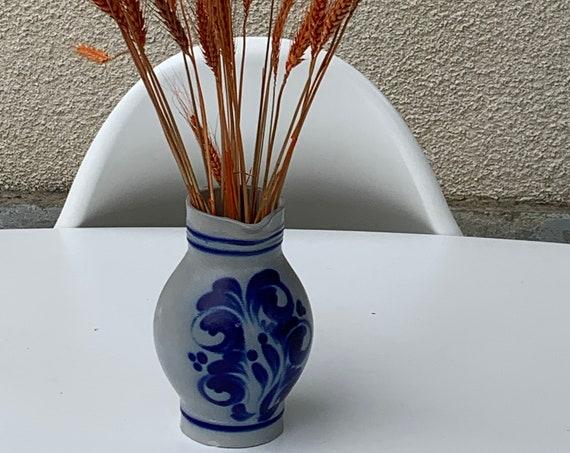 Blue sandstone jug and floral decoration painted in vintage blue