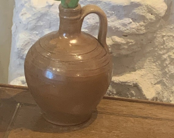 Jug in brown glazed gres with a very original vintage and artisanal shape