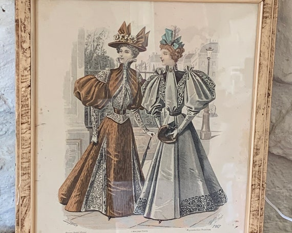 "Fashion plate, ""el salon la moda"" Barcelona. Framed in a weathered wooden frame"