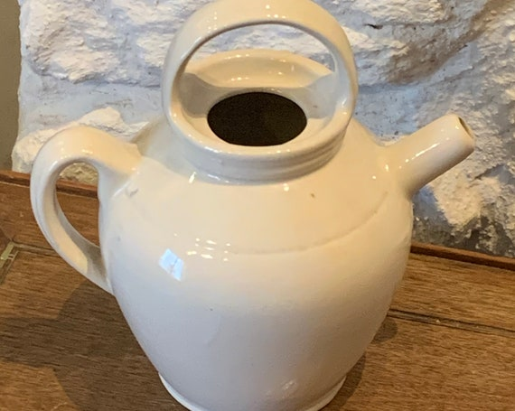 Jug in beige glazed gres with a very original vintage and artisanal shape