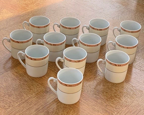 12 white and beige porcelain coffee cups, coral edging with golden leaves, Guy Degrenne, Feuillage model